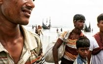 Rohingya fleeing ethnic cleansing in Myanmar's northern Rakhine State arrive on a beach on Cox's Bazar, Bangladesh